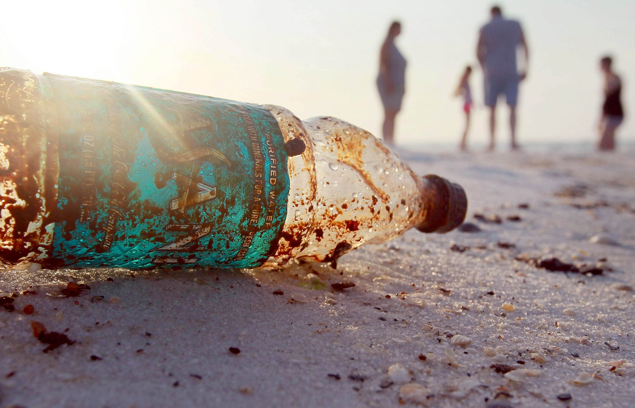 PENSACOLA, FL - JUNE 06:  A plastic bottle is seen coated in oil on Pensacola Beach as oil makes its way on shore from the Deepwater Horizon oil spill in the Gulf of Mexico on June 6, 2010 in Pensacola, Florida. Early reports indicate that BP's latest plan to stem the flow of oil from the site of the Deepwater Horizon incident may be having some sucess.  (Photo by Joe Raedle/Getty Images)